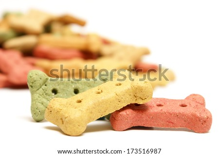 Several dog treats to reward mans best friend. - stock photo