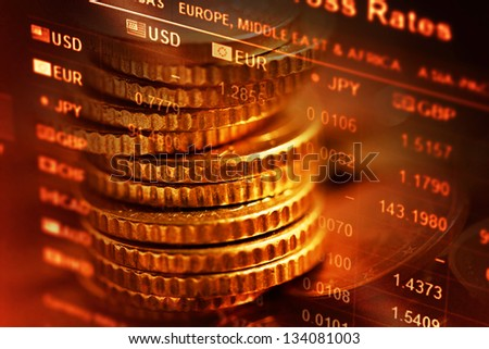Several euro coins and finance data. Selective focus. - stock photo