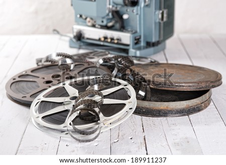 several films and coils placed on an old white wooden table - stock photo
