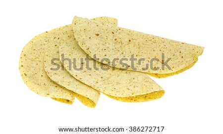Several folded tortilla wraps with garlic and herb flavoring isolated on a white background. - stock photo