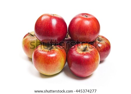 Several fresh red apples. Group of juicy ripe fruits. View of red apples isolated on white background. - stock photo