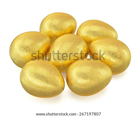 Several golden Easter eggs isolated on white background - stock photo