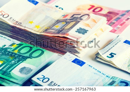 Several hundred euro  banknotes stacked by value. Euro money concept - stock photo