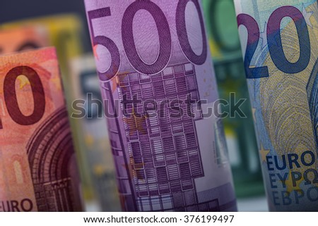 Several hundred euro banknotes stacked by value.Rolls Euro  banknotes.Euro currency money.Announced cancellation of five hundred euro banknotes. Banknotes stacked on each other in different positions - stock photo