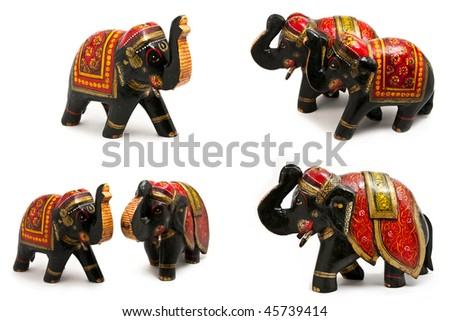 Several indian wooden elephants isolated on white background - stock photo