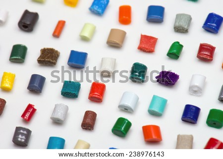 several lonely polymer granulates together on white - stock photo