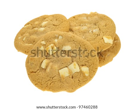 Several macadamia nut cookies with white chocolate on a white background. - stock photo