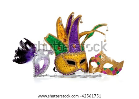 Several mardi gras masks with gold, purple, green and white with copy space on a white background - stock photo