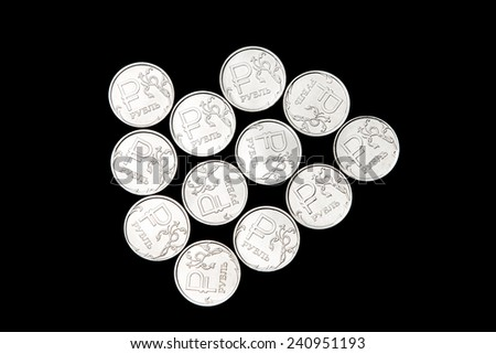 Several metal Russian ruble coins on black background - stock photo