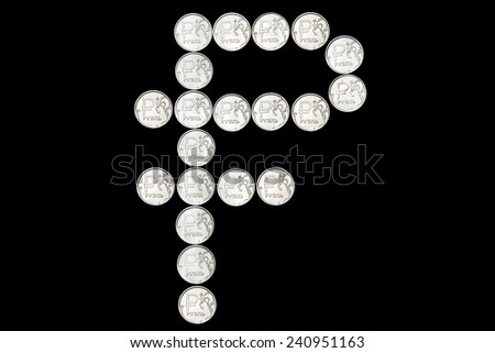 Several metal Russian ruble coins on black background in form of ruble emblem - stock photo