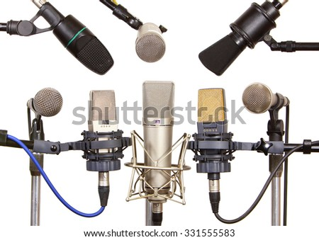 Several microphones prepared for talker isolated on white - stock photo