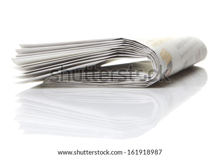 several newspapers, journals stacked on white background - stock photo