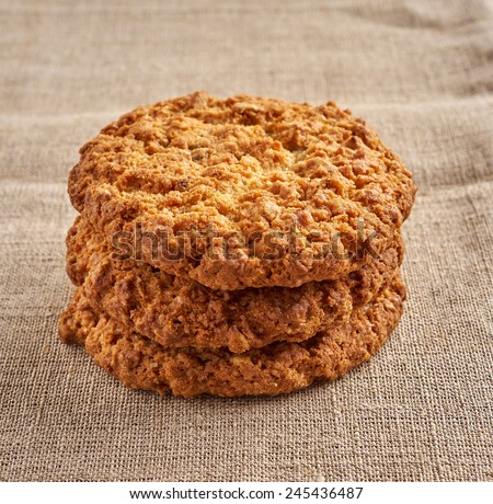 Several oatmeal cookies in a stack, close-up - stock photo