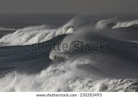Several ocean waves approaching the coast of Portugal. Focus on foreground. - stock photo