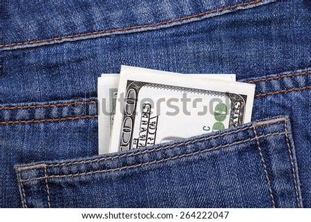 Several of banknotes hundred dollars of USA sticking out of his jeans pocket - stock photo
