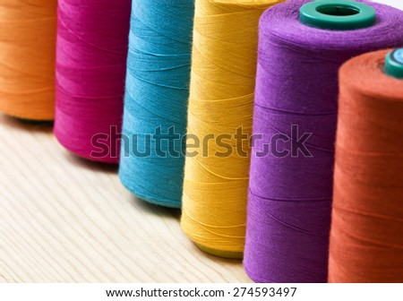 several of multi-colored spools of threads - stock photo
