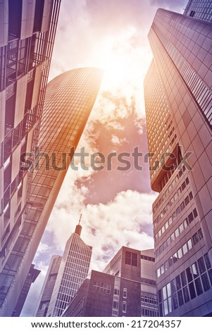 several office towers and buildings in the sun seen from below, Frankfurt am Main, Germany - stock photo