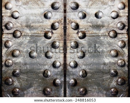 Several old rusty metal plates with rivets - stock photo