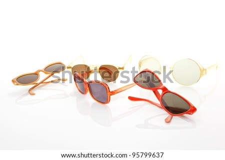Several original retro sunglasses isolated on white background. Vintage objects. - stock photo