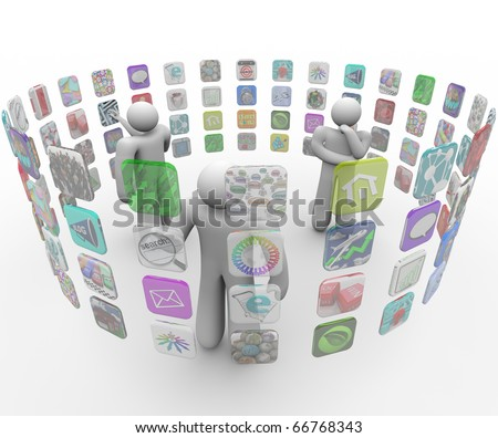 Several people choose applicaitons from projections on a circular wall - stock photo