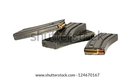 Several 30 round high capacity magazines for AR-15 and AR-16 assault rifles loaded with 5.56 mm ammunition. - stock photo