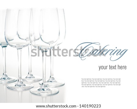 Several same empty  wine glasses on a white background, isolated, ready template - stock photo