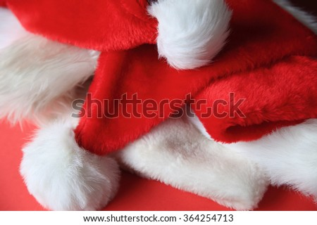 Several Santa Claus hats tossed in a pile - stock photo