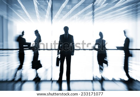 Several  silhouettes of businesspeople interacting  background business centrer - stock photo