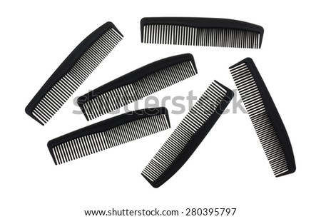 Several small black plastic barber shop combs isolated on a white background - stock photo