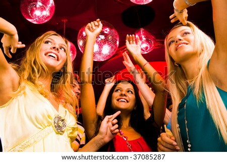Several smart dancers moving at disco and having fun - stock photo