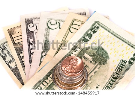 Several stacks of American coins with some dollar bills. - stock photo