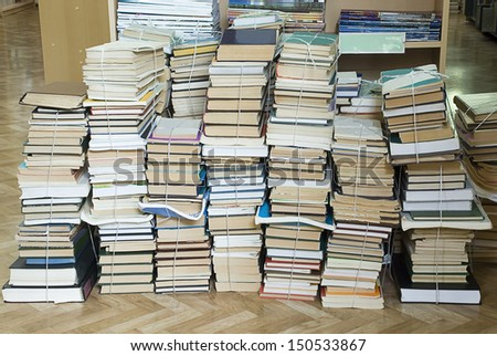several tall stacks of old books - stock photo
