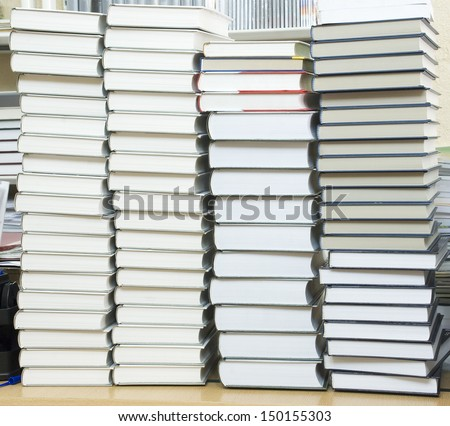 several tall stacks of thick books - stock photo