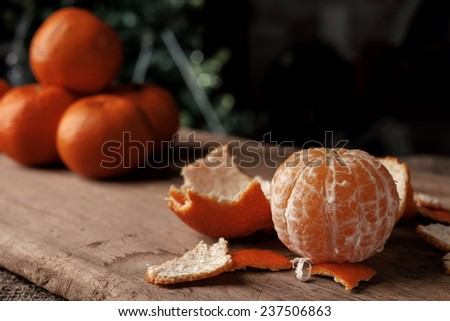 Several tangerines on a wooden background. - stock photo