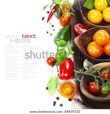 Several varieties of tomatoes and spices over white (with sample text) - stock photo