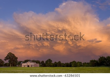 Severe storm mammatus clouds at sunset over a graveyard in Minnesota. - stock photo