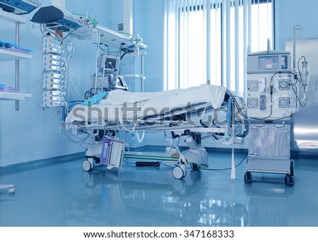 Severely ill patients  in ICU and the dialysis machine - stock photo