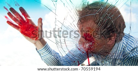 Severely wounded pedestrian hit by a car, being smashed through the windscreen - stock photo