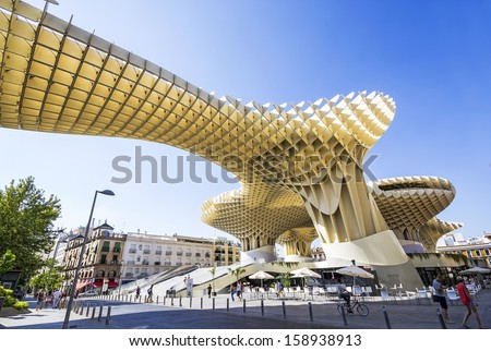 SEVILLA, SPAIN - SEPTEMBER 09: Metropol Parasol in Plaza de la Encarnacion on September 09, 2011 in Sevilla, Spain. J. Mayer H. architects, it is made from bonded timber with a polyurethane coating. - stock photo