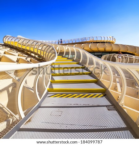 SEVILLA,SPAIN - SEPTEMBER 9: Metropol Parasol in Plaza de la Encarnacion on September 9, 2013 in Sevilla, Spain. J. Mayer H. architects, it is made from bonded timber with a polyurethane coating.  - stock photo