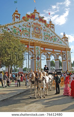 SEVILLE - APRIL 28: An elaborate gate is erected each year during the Feria de Abril on April 28, 2009 in Seville, Spain. - stock photo