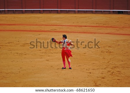 "SEVILLE - APRIL 30:  Bullfighter David Fandila ""El Fandi"" acknowledges the sold out crowd before he goes in for the kill at the Plaza de Toros de Sevilla April 30, 2009 in Seville, Spain. - stock photo"