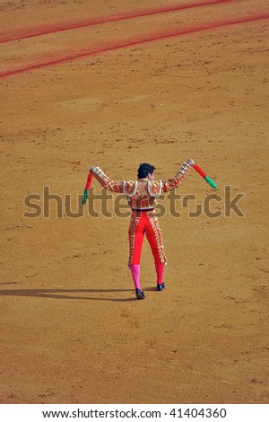 "SEVILLE - APRIL 30:  Bullfighter David Fandila ""El Fandi"" prepares to use the banderillas himself at the Plaza de Toros de Sevilla April 30, 2009 in Seville, Spain. - stock photo"