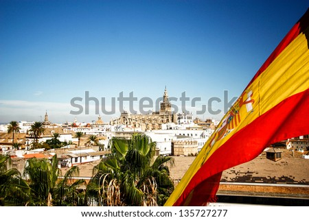 Seville cathedral with Spain flag in Sevilla , Spain - stock photo