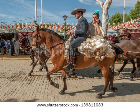 SEVILLE, SPAIN - APR, 25: Horse riders at the Seville's April Fair on April, 25, 2012 in Seville, Spain - stock photo