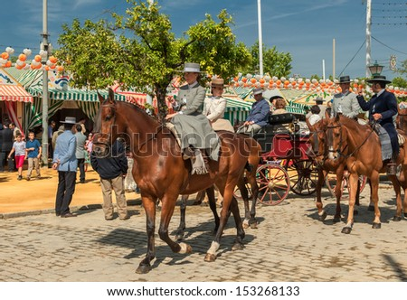 SEVILLE, SPAIN - April, 25: Horse riders at the Seville's April Fair on April, 25, 2012 in Seville, Spain - stock photo