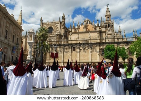 SEVILLE, SPAIN - APRIL 7, 2009 - Members of El Cerro brotherhood walking around the Cathedral during Santa Semana, Seville, Seville Province, Andalusia, Spain, Western Europe, April 7, 2009. - stock photo