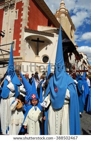 SEVILLE, SPAIN - APRIL 7, 2009 - Members of the San Esteban brotherhood walking through the city centre streets during Santa Semana, Seville, Andalusia, Spain, Western Europe, April 7, 2009. - stock photo
