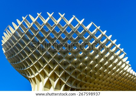 Seville, Spain -January 17, 2015: Metropol Parasol in Plaza de la Encarnacion. This wooden structure designed by J. Mayer-Hermann is made from bonded timber with a polyurethane coating. - stock photo