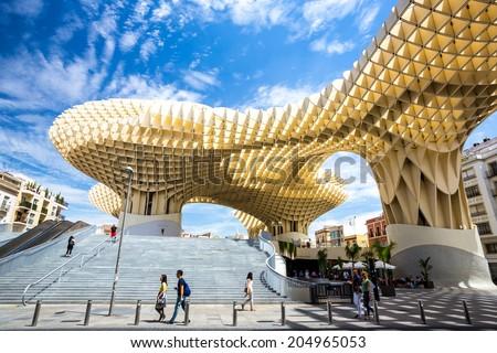 Seville, Spain, Jun 2014: Metropol Parasol is the modern architecture on Plaza de la Encarnacion on Jun 5, 2014 in Seville, Spain.  It was designed by the German architect Jurgen Mayer-Hermann. - stock photo